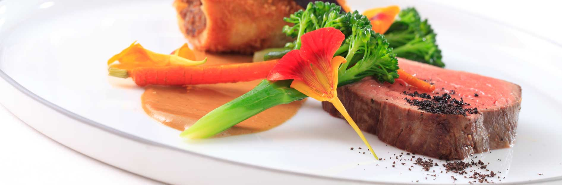 Fillet of beef with treacle cured ox cheek hash, shallot puree, heritage carrot and tenderstem